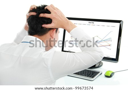 Business man having stress looking at chart in the office