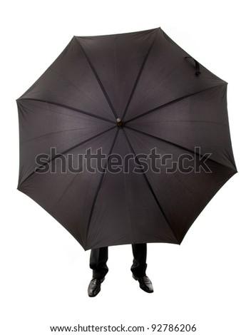 Business man hidden in umbrella against white background
