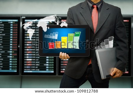 Business man hold laptop and graph report