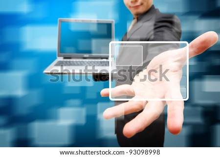 Business man hold notebook computer and windows background
