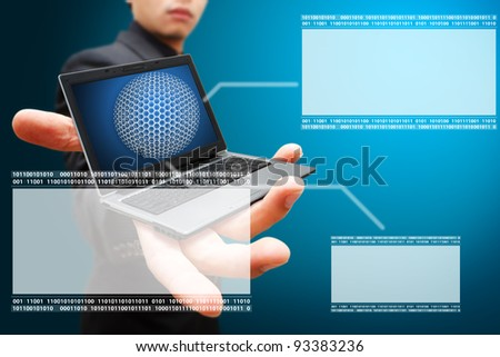 Business man hold notebook computer and windows background - stock photo