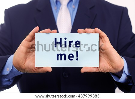 Business man hold paper hire me text on it