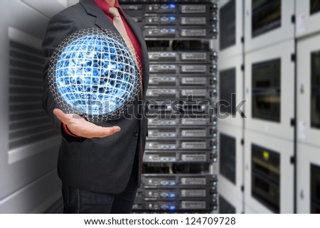 Business man hold the digital earth in data center room : Elements of this image furnished by NASA
