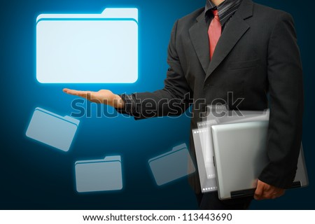 Business man hold the folder icon from laptop