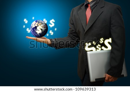 Business man hold the world and Money icon : Elements of this image furnished by NASA