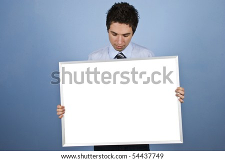 Business man holding a blank banner and looking down to copy space