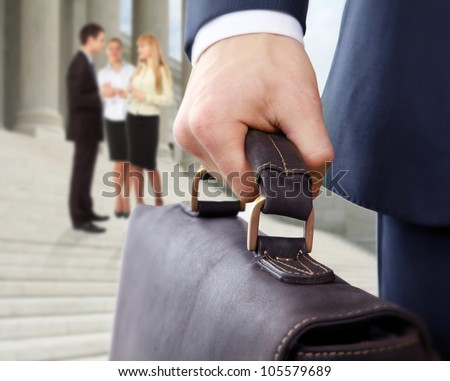 business man holding a briefcase - stock photo
