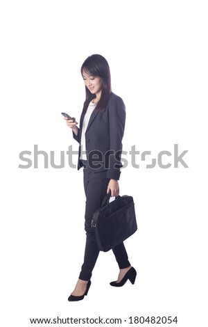 business man holding a briefcase and use phone on white background