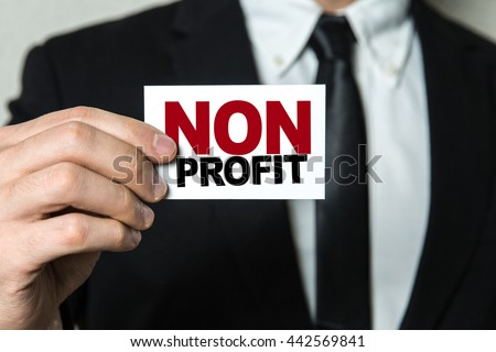 Business man holding a card with the text: Non Profit