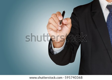 business man holding a pen on...