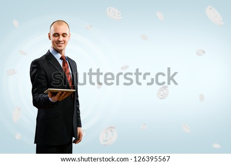 business man holding a tablet, fly around the signs e-mail