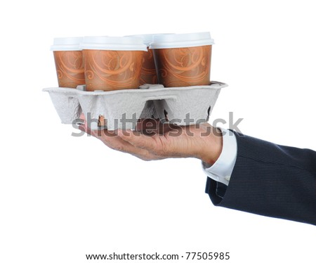 Business man holding a take out tray of disposable coffee cups. Arm only in horizontal format isolated on white.