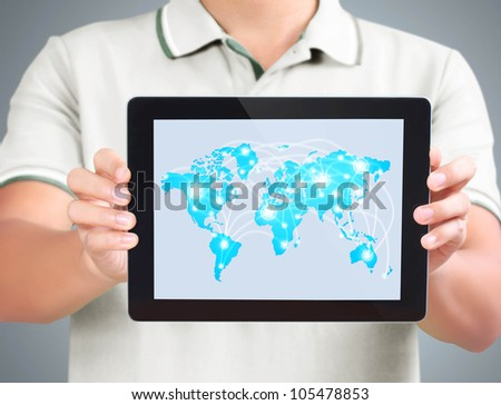 Business man holding and shows tablet