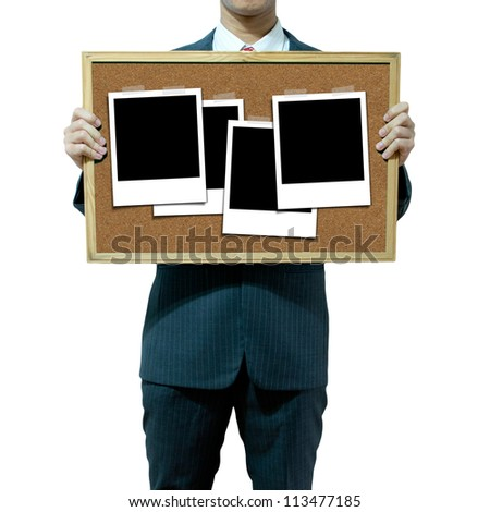Business man holding cork board on the background