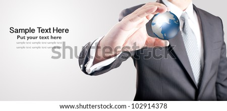 Business man holding digital globe with blank space for text on left