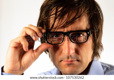 Business man holding eyeglass