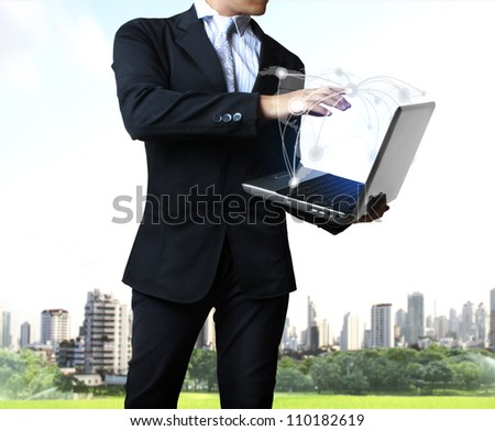 business man holding his laptop