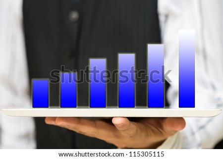 Business man holding Holographic bar graph on tablet pc