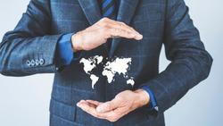 Business man holding illustration world