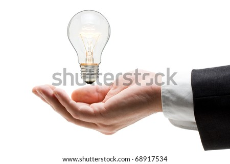 Business man holding light bulb in his hand - creativity concept - stock photo