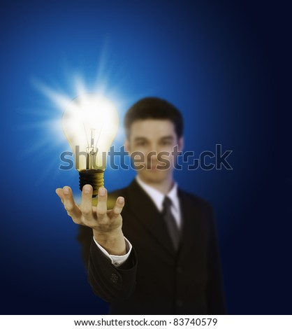 business man holding light bulb ,thinking of new idea
