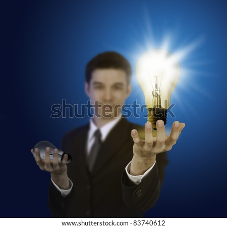 business man holding light bulb ,thinking of new idea
