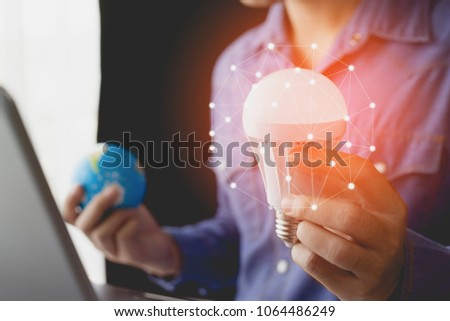 Business man holding light bulbs, ideas of new ideas with innovation and inspiration concept. #1064486249