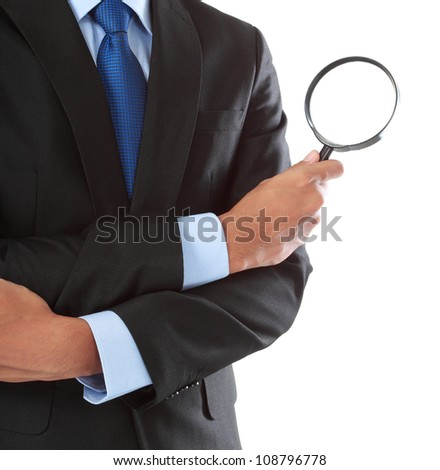business man holding magnifying glass isolated on white background