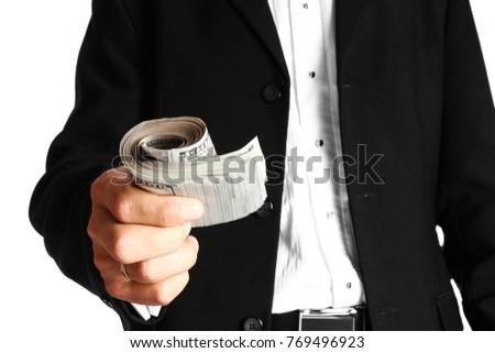 Business man holding money on white background