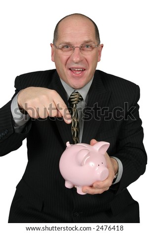Business man holding Piggy Bank in front of him and pointing to it
