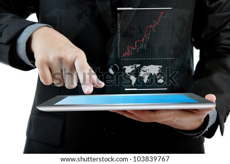 Business man holding the modern digital tablet pc with success growth chart