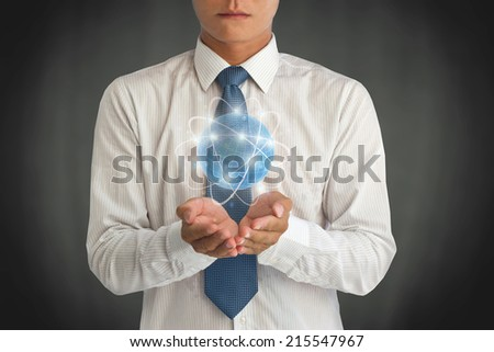 Business man holding the small world in his hands against dark background