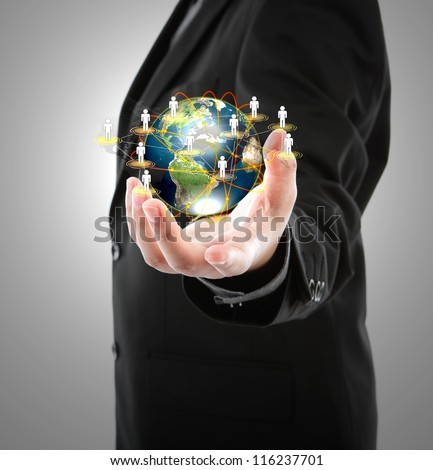 Business man holding the small world in his hands against white background (Elements of this image furnished by NASA)