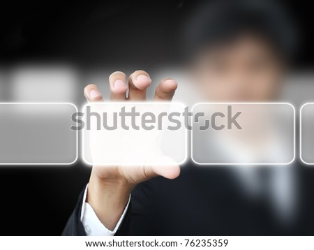 Business man holding touch screen