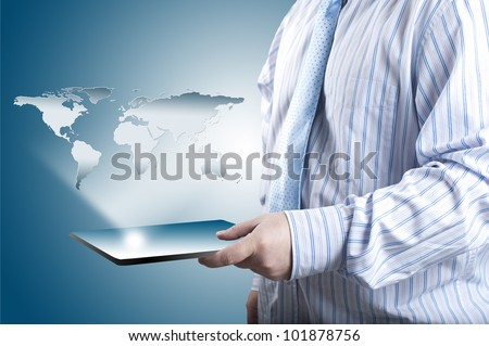 Business man holding touch screen tablet PC with 3D world map raising from the screen. Concept for connectivity