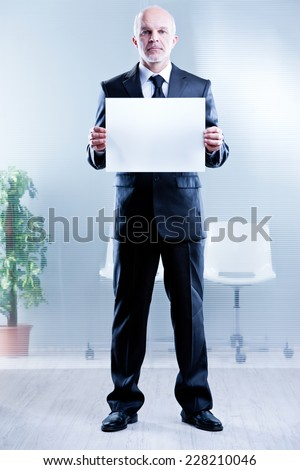 business man holding up a blank sign in which you can write your own text