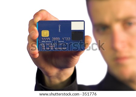 business man holding up a credit card - note: the numbers on credit card are made up as well as all the other numbers on the card