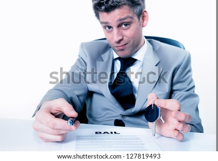 Business man holds key and lease agreement document  in hands