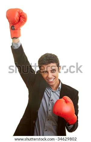Business man holds up his hand with red boxing gloves