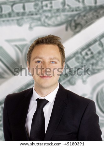 Business man in a dark suit and tie against a background of dollar bills