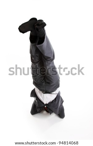 Business man in a headstand
