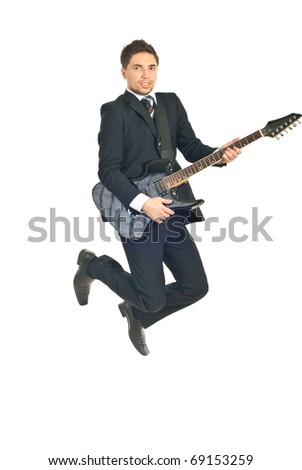 Business man in black suit jumping with guitar isolated on white background