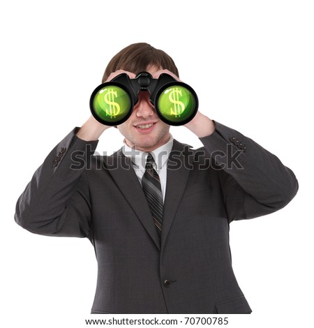 business man in black suit looking through binoculars