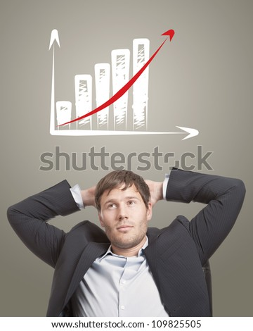 Business man in chair thinking with a rising chart diagram over his head