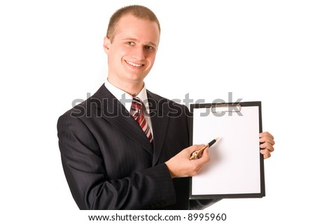 Business man in dark suit holding clipboard - stock photo