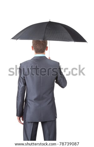 Business man in elegant modern suit hold an umbrella standing back, isolated over white background. Empty copy space. Concept.