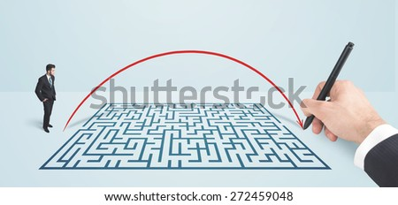 Business man in front of hand drawn maze thinking how to get through
