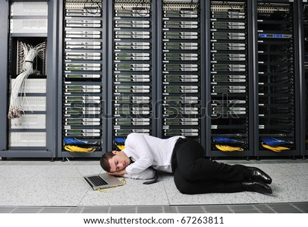 business man in network server room have problems and looking for  disaster solution