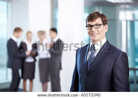 Business man in office compared to other staff