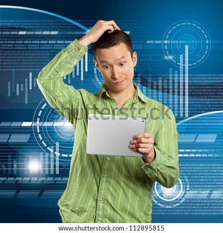 Business man in suit with touch pad in his hands